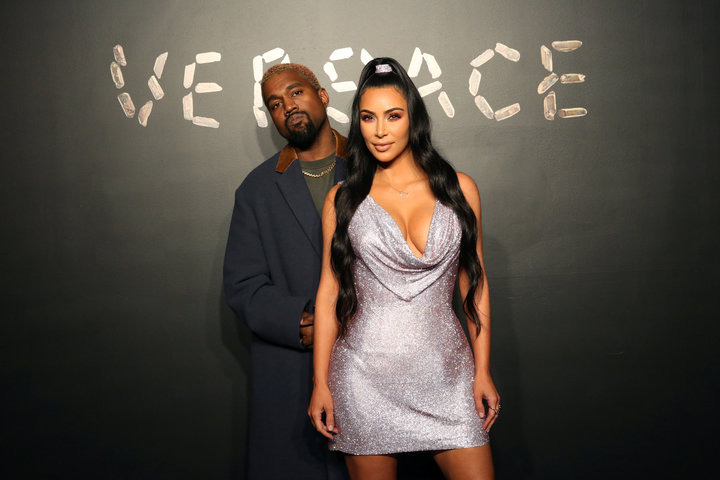 Kanye West and Kim Kardashian pose for a photo before attending the Versace presentation in New York